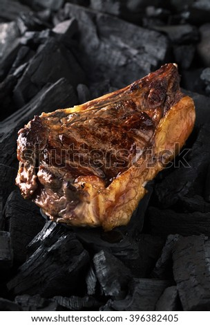 Grill steak marbled ribeye roasts over charcoal
