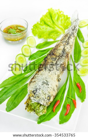 grill striped snakehead fish with salt coated