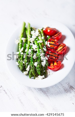 Grilled Asparagus and Cherry Tomatoes with Feta - stock photo