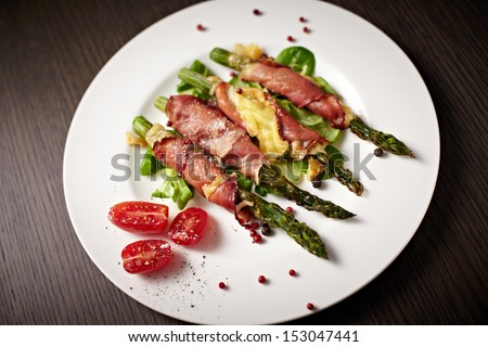 Grilled asparagus with spices. - stock photo