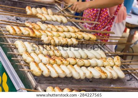 Grilled bananas, Thai dessert on the streets of Bangkok - stock photo