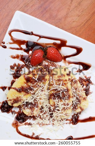 grilled bananas topped with cheese and chocolate - stock photo