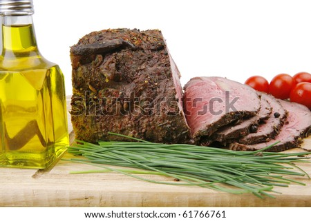 grilled barbecue on wooden plate with vegetables - stock photo