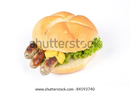 Grilled bavarian sausages in a roll - stock photo