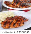 Grilled bbq chicken breasts on a plate - stock photo