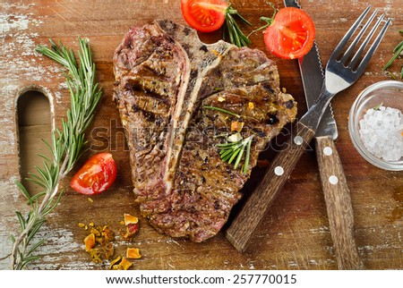 Grilled BBQ Steak with Fresh Herbs. - stock photo