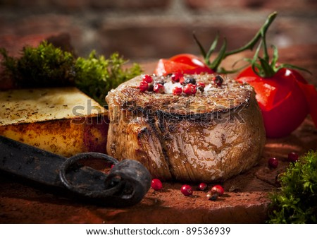 Grilled bbq steak with potato cube and tomatoes. - stock photo