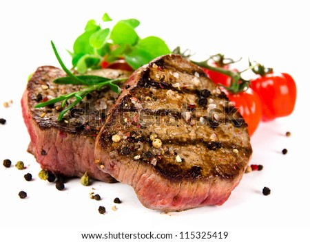 Grilled bbq steaks on white background - stock photo