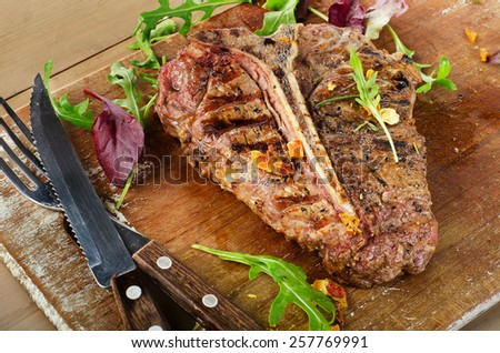 Grilled BBQ T-Bone Steak with Herbs. - stock photo