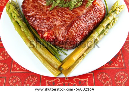 grilled beef meat served with pepper and asparagus - stock photo