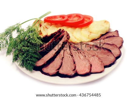 grilled beef meat steak with fried potatoes and tomatoes on white plate isolated over white - stock photo