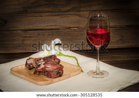 grilled beef meat with red wine - stock photo
