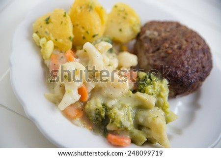 grilled beef meatball with potatoes and vegetables - stock photo