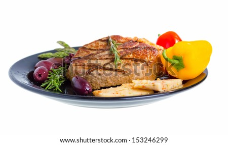 Grilled beef on plate served with olives, rosemary, aged cheese and vegetables isolated on white background. - stock photo