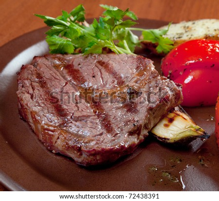 Grilled beef on white plate  with vegetable