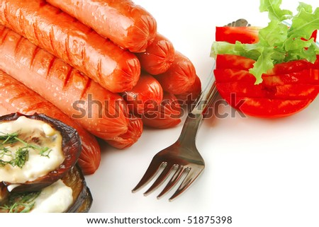 grilled beef sausages served on white background - stock photo