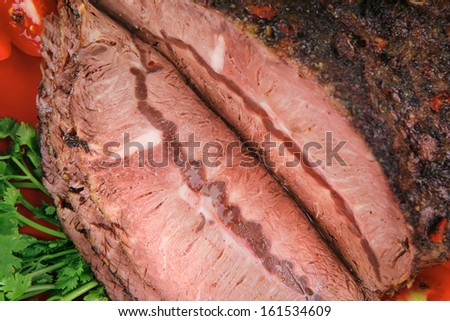 grilled beef sliced on red plate over white - stock photo