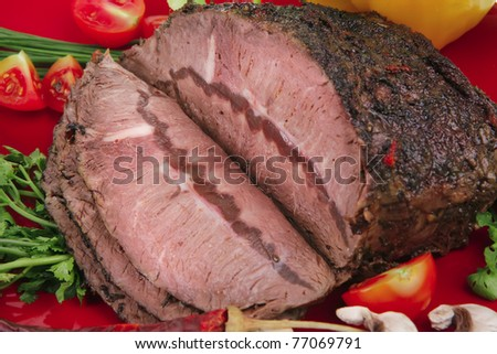grilled beef sliced on red plate over white