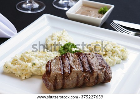 grilled beef steak and risotto