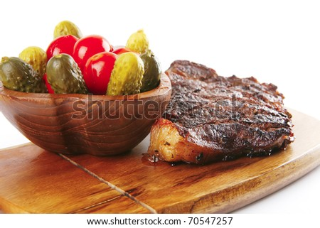 grilled beef steak and vegetables on wooden plate isolated over white background . shallow dof - stock photo