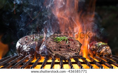 Grilled beef steak on the grill, close-up. - stock photo