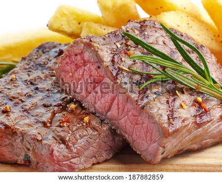 grilled beef steak on wooden cutting board - stock photo