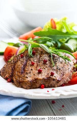 Grilled beef steak with fresh vegetables - stock photo