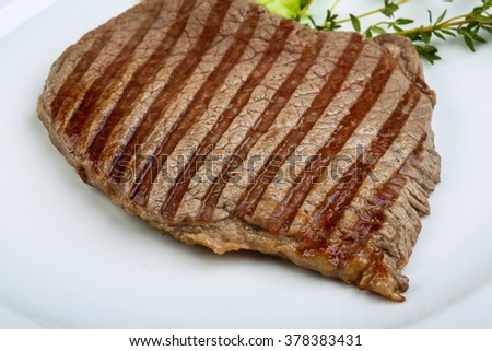 Grilled beef steak with herbs and spices - stock photo