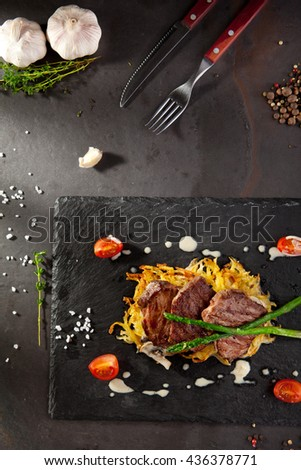 Grilled Beef Steak with Potato and Mushrooms. Garnished with Cherry Tomatoes and Asparagus - stock photo