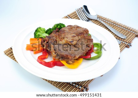 grilled beef steak with vegetable on wooden plate