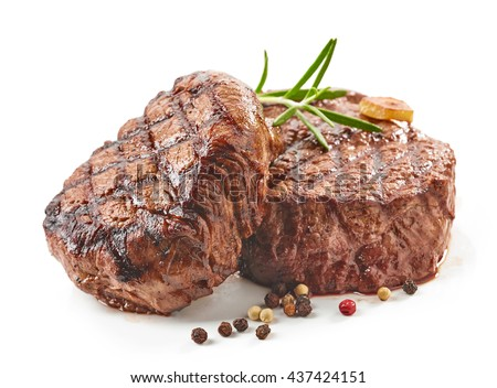 grilled beef steaks with spices isolated on white background - stock photo