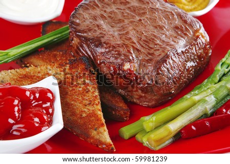 grilled beef with toasted bread on red dish