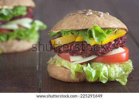 grilled beet burger in whole grain bun - stock photo