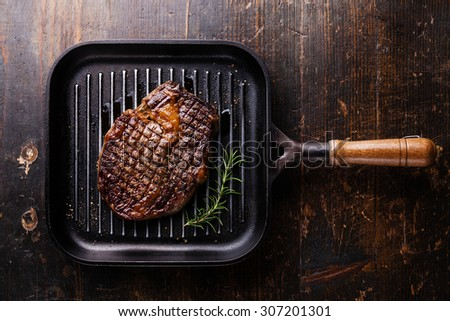 Grilled Black Angus Steak Ribeye on grill pan on wooden background  - stock photo