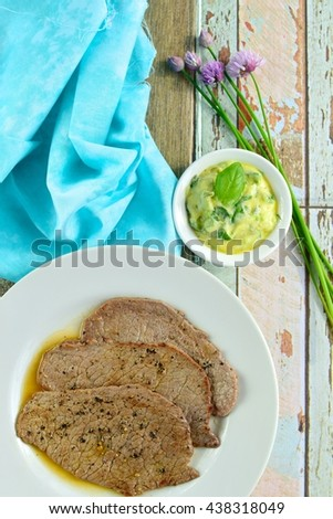 Grilled black pepper minute steak with basil butter