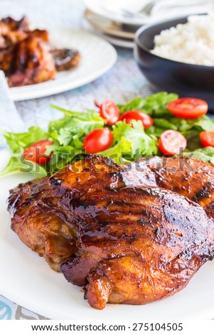 Grilled boneless chicken thighs marinated and basted in a mixture of guava jam, shoyu, oyster sauce and seasonings - stock photo