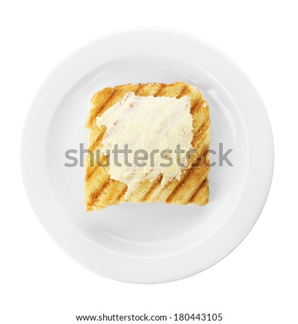Grilled bread with butter, isolated on white - stock photo