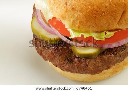 Grilled burger on a wheat bun - stock photo