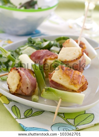 Grilled cheese kebab with spring onion, selective focus