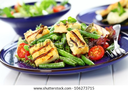 Grilled cheese on green beans with tomatoes - stock photo