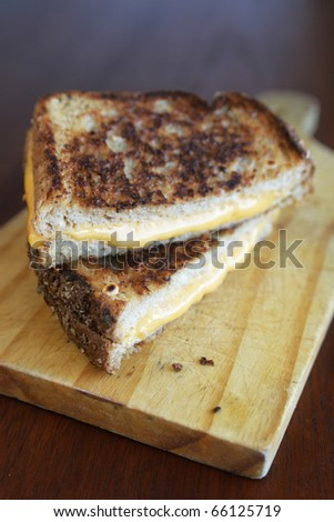 Grilled cheese sandwich on a cut board - stock photo