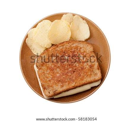grilled cheese sandwich on a plate with chips isolated over white - stock photo