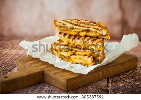 Grilled cheese sandwich with caramelized apples - stock photo