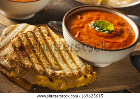 Grilled Cheese Sandwich with Creamy Tomato Basil Soup - stock photo