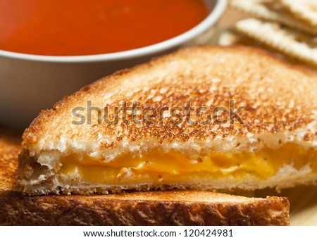 Grilled cheese sandwich with tomato soup. - stock photo