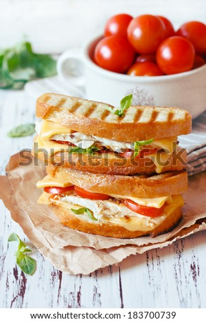 Grilled cheese sandwiches with chicken and vegetables. - stock photo
