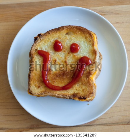Grilled Cheese with Ketchup Happy Face - stock photo