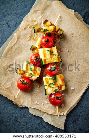 Grilled Cherry Tomato, Zucchini and Halloumi Skewers - stock photo