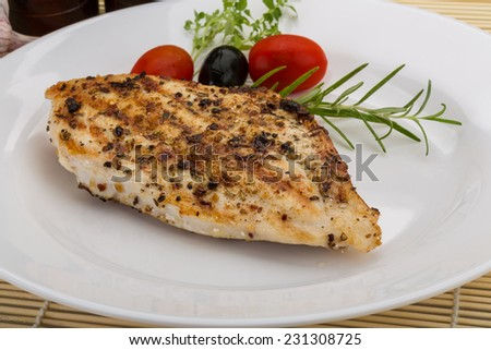 Grilled chichen breast - on the plate with spices - stock photo