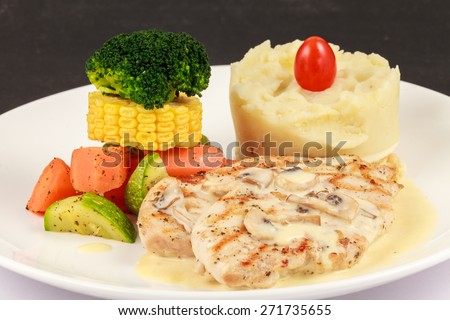 Grilled chicken :An delicious grilled chicken dish with white mushrooms sauce  Location : At Rawan Cake in Amman ,Jordan - stock photo